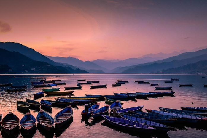 Boats in a lake at sunset