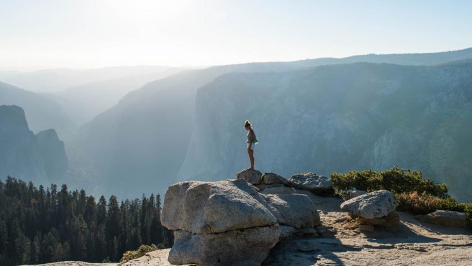 Woman standing on rock in the mountains